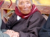 Elderly pilgrim at Drepung Monastery