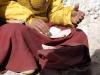 Monk reading pecha scriptures
