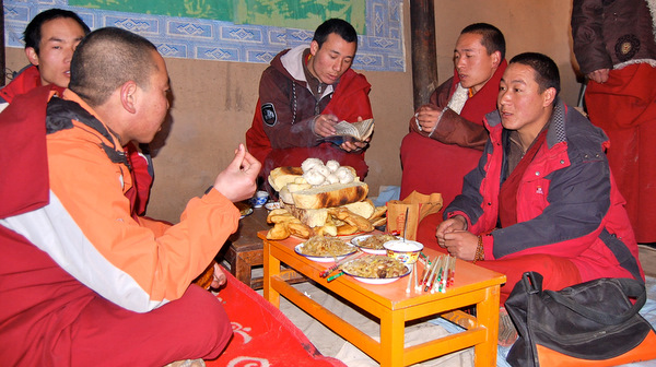 Monks giving a blessing in a home for Losar